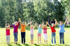 Kids outside in park Royalty Free Stock Image