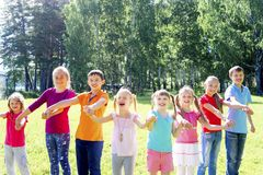 Kids outside in park Royalty Free Stock Images