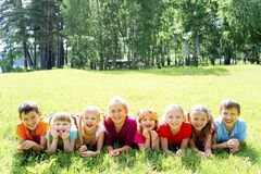 Kids outside in park. Group of kids playing outside in a park Stock Image