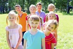 Kids outside in park Stock Photo