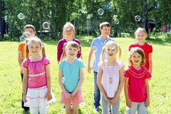 Kids outside in park Stock Photography