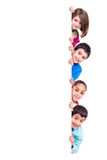 Kids over white board Royalty Free Stock Image
