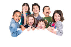 Kids over white board Stock Photography
