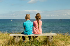 Kids overlooking the ocean. Young caucasian kids in Denmark on a summer day Royalty Free Stock Photos