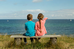 Kids overlooking the ocean. Young caucasian kids in Denmark on a summer day Stock Photography