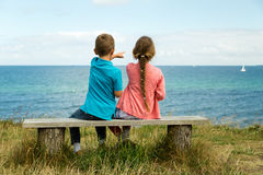 Kids overlooking the ocean. Young caucasian kids in Denmark on a summer day Stock Photo