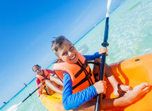 Kids paddling in kayak Stock Images
