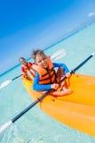 Kids paddling in kayak Royalty Free Stock Photography