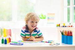 Kids paint. Child painting. Little boy drawing stock photos
