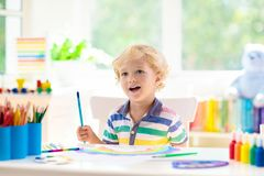Kids paint. Child painting. Little boy drawing royalty free stock images
