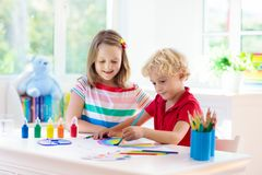 Kids paint. Child painting. Little boy drawing stock image