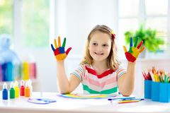 Kids paint. Child painting. Little girl drawing stock photos