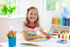 Kids paint. Child painting. Little girl drawing royalty free stock photography