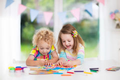 Kids paint and draw at home royalty free stock image