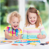 Kids paint and draw at home Stock Photo