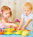 Kids paint Easter eggs Royalty Free Stock Photography