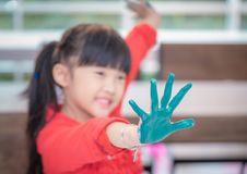 Kids with painted hand in art classroom. Kids with dirty painted hand in art classroom royalty free stock photos