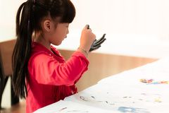 Kids with painted hand in art classroom. Kids with dirty painted hand in art classroom stock photo