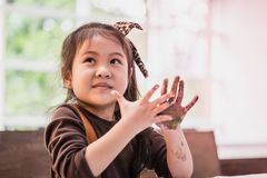 Kids with painted hand in art classroom. Kids with dirty painted hand in art classroom stock image