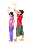 Kids painters. Little painters two kids in coveralls with paint rollers rear view, Isolated on white with clipping path Stock Photography