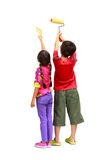 Kids painters. Little painters two kids in coveralls with paint rollers rear view, Isolated on white with clipping path Stock Photo
