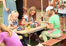 Kids painting ceramics Royalty Free Stock Image