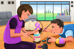 Kids Painting Easter Eggs. A vector illustration of kids painting Easter eggs at home Royalty Free Stock Photography