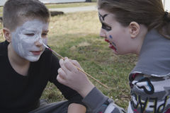 Kids painting faces Royalty Free Stock Photo