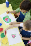 Kids Painting Outside royalty free stock photos