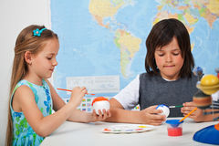 Kids painting the planets - for a solar system scale model. Kids painting the planets in art and science class - for a solar system scale model- focus on the royalty free stock images
