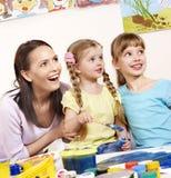 Kids painting in preschool. Royalty Free Stock Images