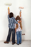 Kids painting the room in their new home Stock Photo