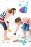 Kids while painting their feet Royalty Free Stock Image