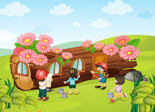 Kids painting wooden house Royalty Free Stock Photo