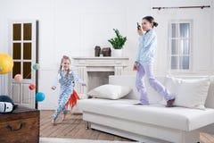 Kids in pajamas playing cosmonauts Stock Photos