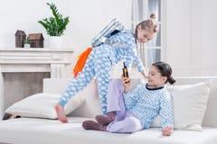 Kids in pajamas playing cosmonauts Stock Photo