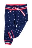 Kids pants isolated. A stylish fashionable dark blue denim trousers with white dots for the little girl. Children sport trousers.  royalty free stock photography