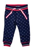 Kids pants isolated. A stylish fashionable dark blue denim trousers with white dots for the little girl. Children sport trousers.  stock images