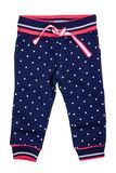 Kids pants isolated. A stylish fashionable dark blue denim trousers with white dots for the little girl. Children sport trousers.  stock image