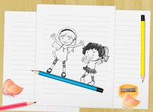 Kids on paper Royalty Free Stock Photography