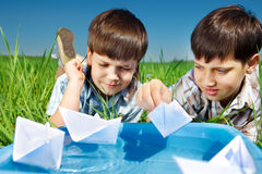 Kids with paper boats royalty free stock image