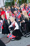 The kids during parade at norwegian constitution day. The festively dressed kids at norwegian constitution day during parade royalty free stock images
