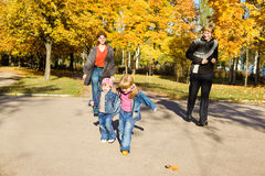 Kids with parents in autumn park Stock Images