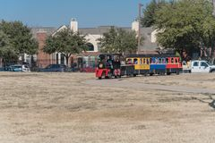 Kids and parents enjoy Choo Choo Train riding at Frost Fest event in Irving, Texas. IRVING, TX, US-JAN 26, 2019: Choo Choo train rides around the Cimarron park royalty free stock photography