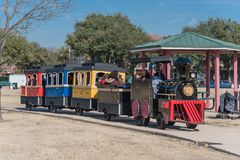 Kids and parents enjoy Choo Choo Train riding at Frost Fest event in Irving, Texas. IRVING, TX, US-JAN 26, 2019: Choo Choo train rides around the Cimarron park stock images