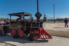 Kids and parents enjoy Choo Choo Train riding at Frost Fest event in Irving, Texas. IRVING, TX, US-JAN 26, 2019: Choo Choo train rides around the Cimarron park stock photography