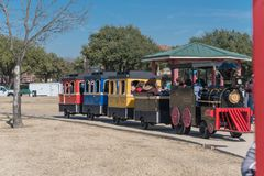 Kids and parents enjoy Choo Choo Train riding at Frost Fest event in Irving, Texas. IRVING, TX, US-JAN 26, 2019: Choo Choo train rides around the Cimarron park stock photo