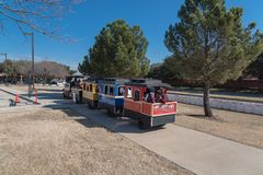 Kids and parents enjoy Choo Choo Train riding at Frost Fest event in Irving, Texas. IRVING, TX, US-JAN 26, 2019: Choo Choo train rides around the Cimarron park royalty free stock photo