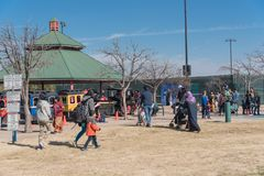 Kids and parents enjoy Choo Choo Train riding at Frost Fest event in Irving, Texas. IRVING, TX, US-JAN 26, 2019: Choo Choo train rides around the Cimarron park stock photos