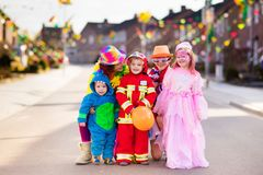 Kids and parents on Halloween trick or treat Royalty Free Stock Image